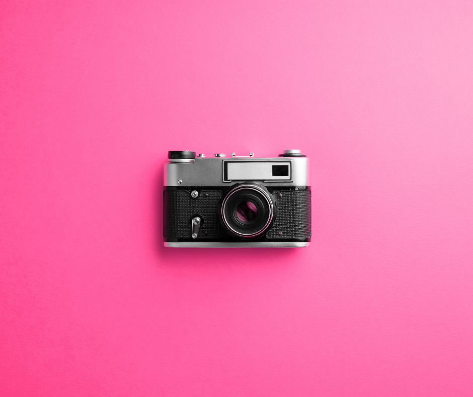 Camera on a hot pink background